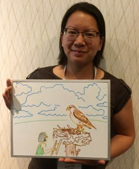 "Janet Ng studies effects of human development on birds of prey, like this larger-than-life Ferruginous Hawk (""All birds are larger than life,"" she said)."