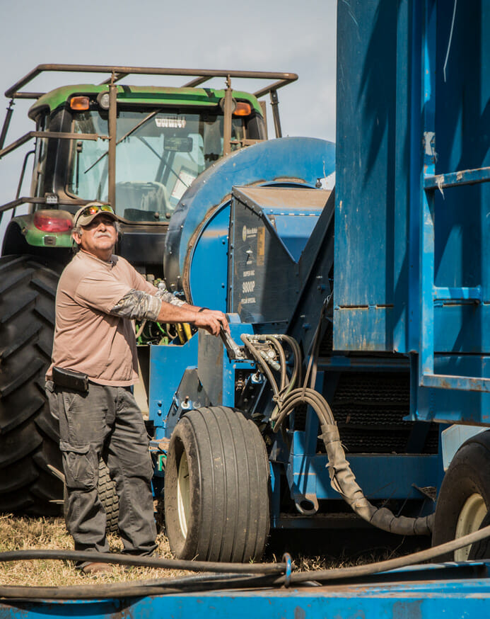 American pecan farmer with tractor.