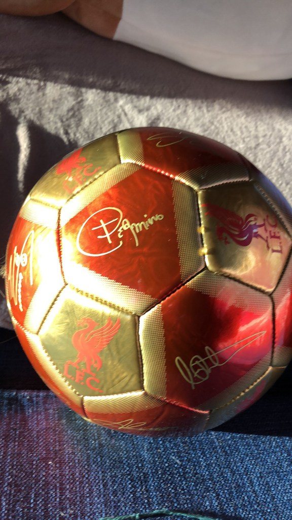 Signed soccer ball in gold and red