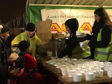 Volunteers handing out hot tea