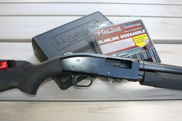 The author's Mossberg 50 pump shotgun and Tac Star's handy Side Saddle Slimline accessory prior to easy assembly.