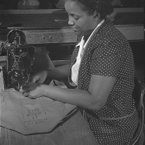 Making canvas containers for Army gas masks. Edgewood Arsenal, Maryland. June, 1942. Photo by Jack Delano. Library of Congress collections.