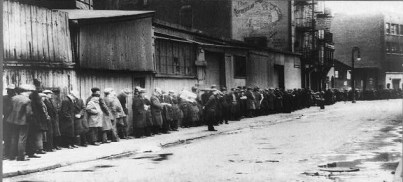 Breadline at McCauley Water Street Mission under Brooklyn Bridge, New York 1930-1934. Photo by Ewing Galloway.