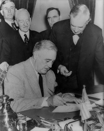 President Roosevelt Signing the Declaration of War Against Germany. December 11, 1941. Office of War Information Photo.