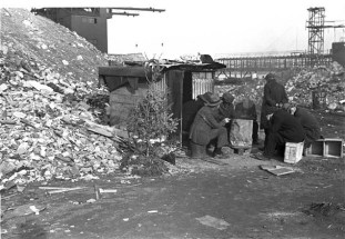 Unemployed Men in Front of Shack with Christmas Tree. E. 12th St. NYC, 1938. Photo by Russell Lee.