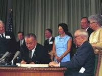 LBJ signs Medicare into law on July 30, 1965. (lbjlibrary)