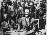 FDR at a CCC camp: His New Deal prepared the nation for an industrial boom during World War II.