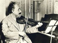 Albert Einstein playing his violin.