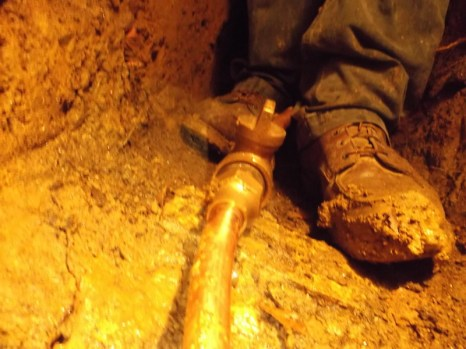 muddy-boots-in-trench