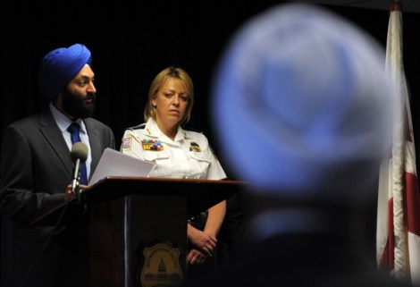 """EWEL SAMAD/AFP/GETTY IMAGES - Metropolitan Police Chief Cathy Lanier listens as Jasjit Singh, Executive Director, Sikh American Legal Defense and Education Fund, speaks during an event to release the department's new uniform and appearance rules May 16 at MPD headquarters in Washington."" (source: Washington Post)"