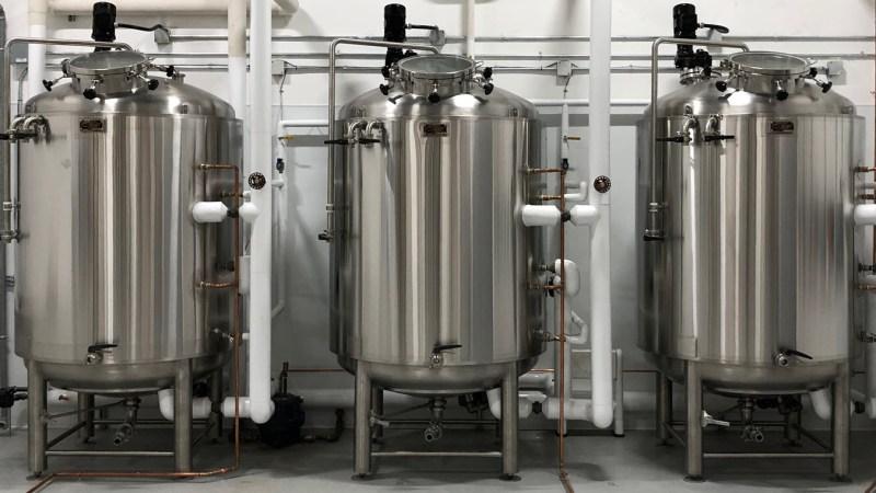 Three silver dome top fermenters