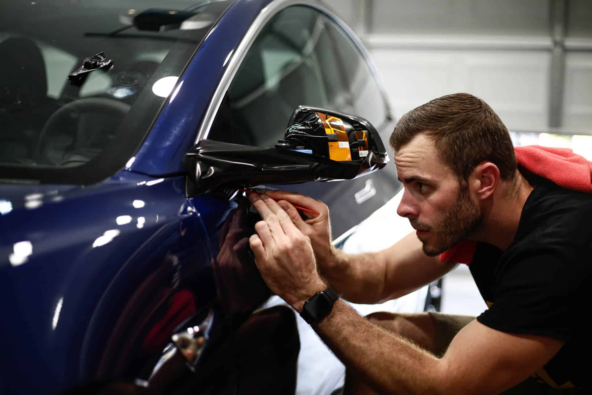 World's Best Paint Protection Installer Tyler O'Hara working on Tesla