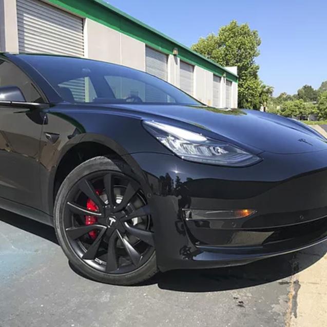 XPEL Paint Protection installation on black chrome Tesla