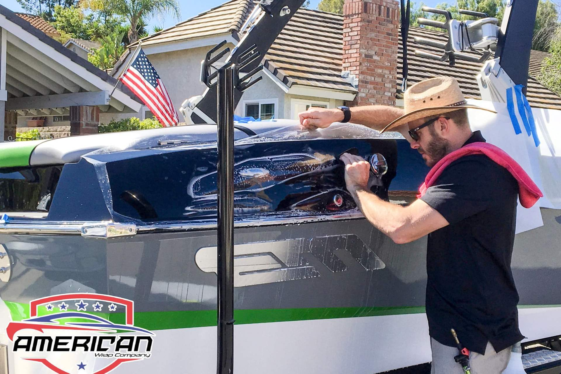 World's Best Paint Protection Installer Tyler O'Hara wrapping boat