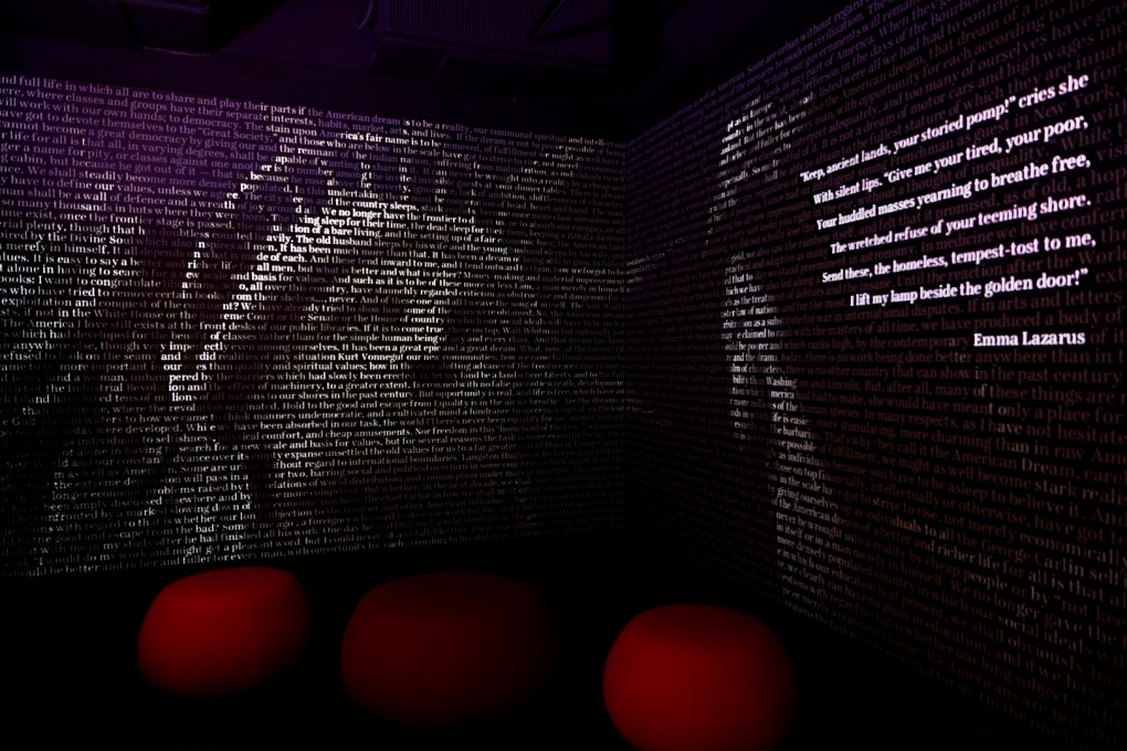 An exhibit at the AWM featuring words lit to look like the Statue of Liberty