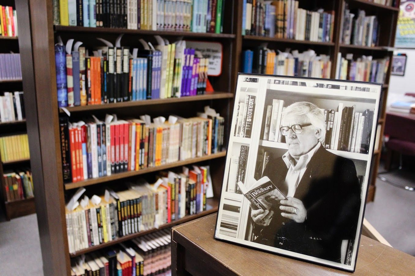 Framed photo of Ray Bradbury in front of bookshelves