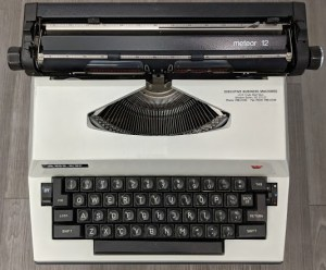 Top-down image of Maya Angelou's Meteor 12 typewriter on display at the American Writers Museum