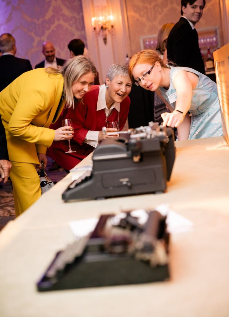 Attendees with typewriters at the American Writers Museum Annual Benefit