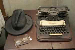 Joel Chandler Harris's typewriter, hat and spectacles on display at The Wren's Nest