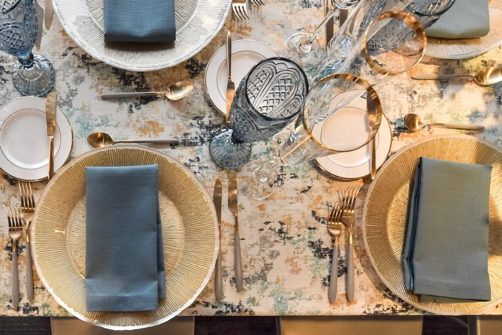 A white and gray colored table setting at a private event at the American Writers Museum in Chicago