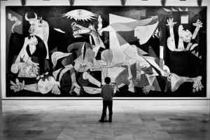 Black and white photo of a child looking at art