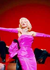 Phot of Marilyn Monroe in a pink dress.