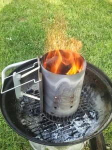 Lit lump charcoal in Weber chimney
