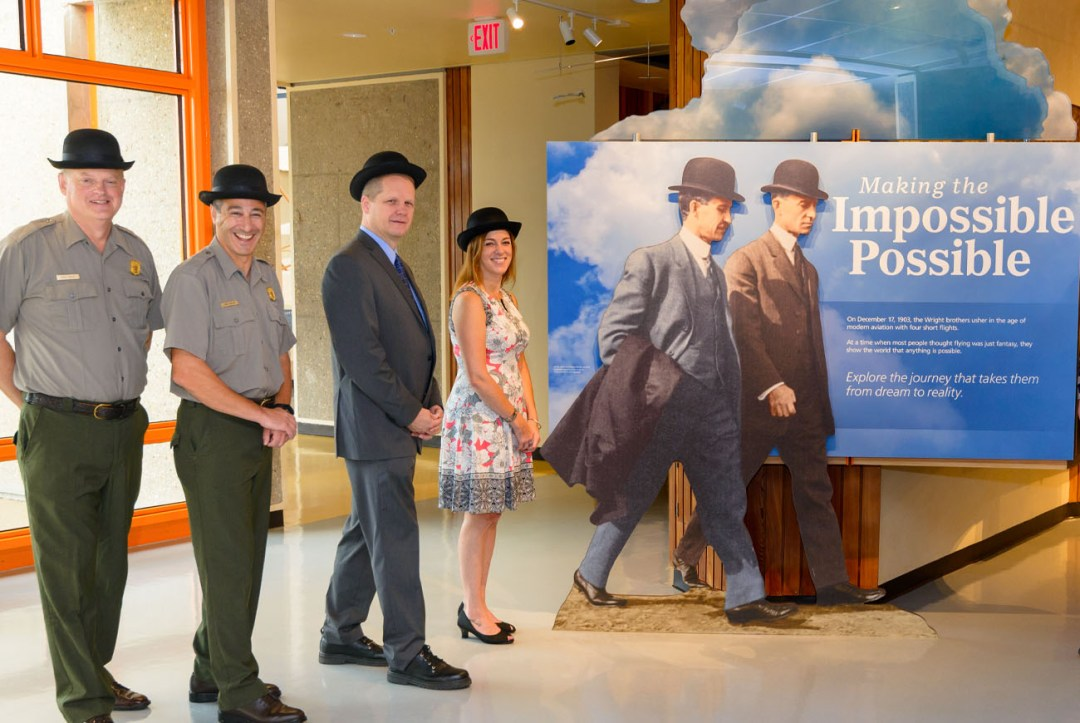 Kevin Kissling and Megan Shelley pose with two rangers in Bowler hats