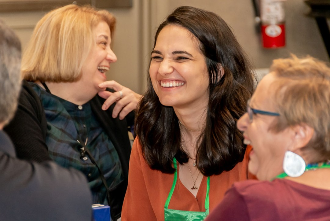 Picture of Julianna laughing in center with other EN employees laughing around her.