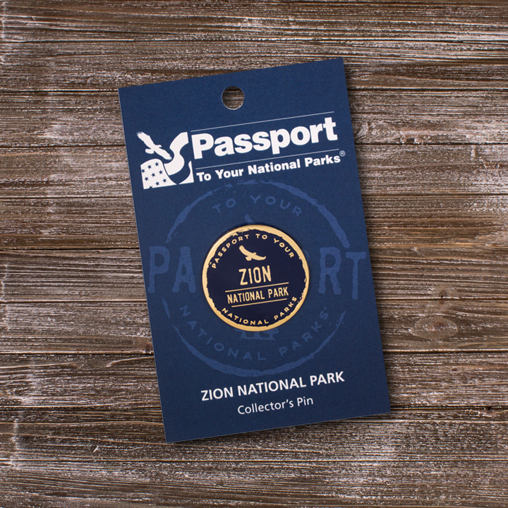 Passport logo-style pin with Zion National Park on it