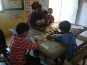 Forming structured sentences with the children.