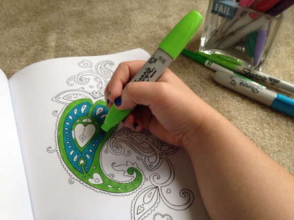 markers and adult coloring book