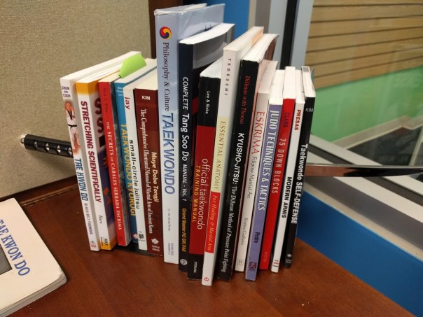 The books that currently live on my desk.