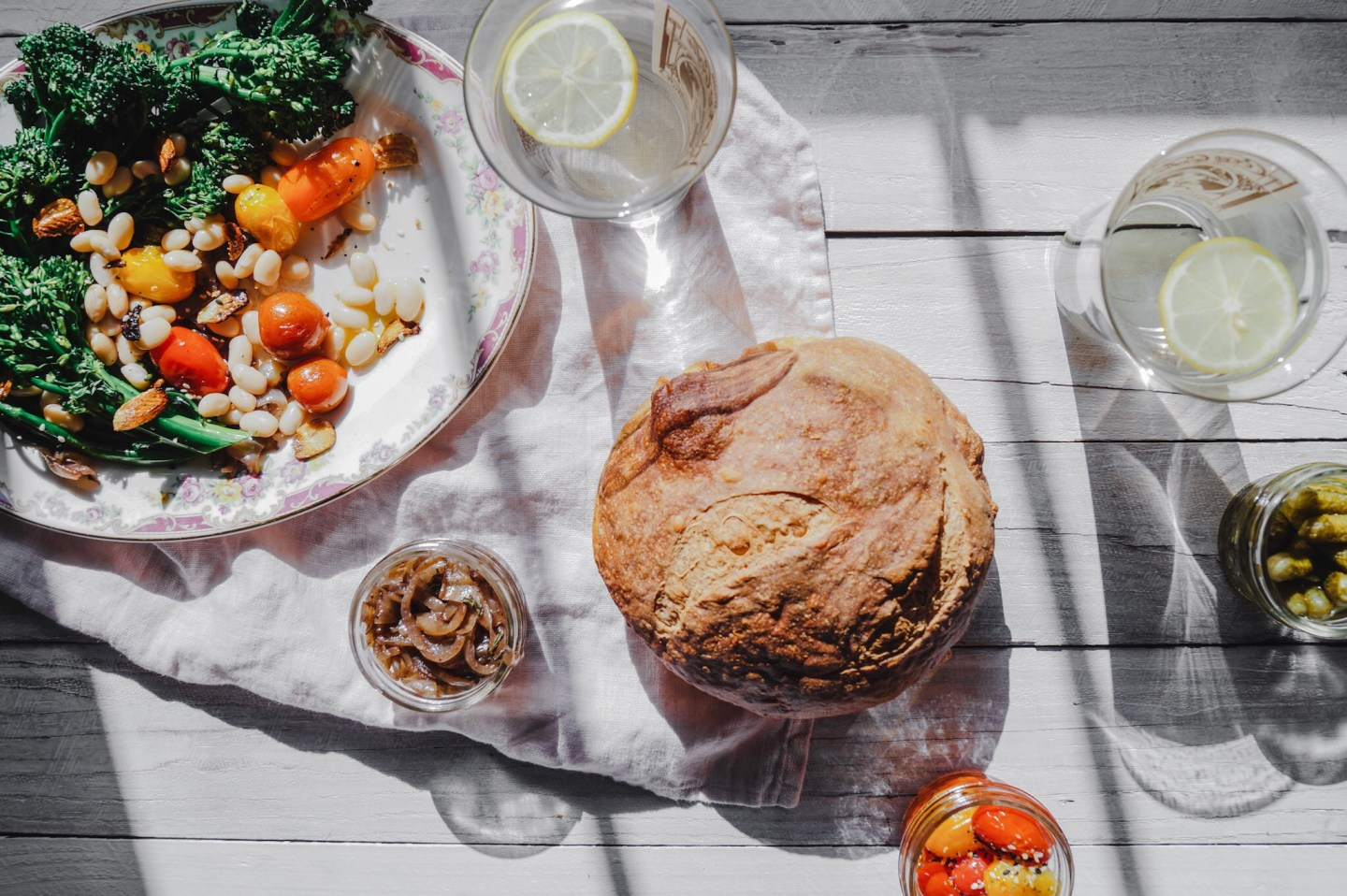 Crusty rustic homemade bread and a roasted tomato salad.