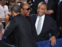 US President Barack Obama hugs muscian S