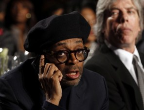 Spike Lee listens to Obama at the National Action Network's Keepers of the Dream Awards Gala in New York