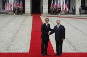 U.S. President Obama and Polish President Komorowski shake hands during a welcome ceremony at the Presidential Palace in Warsaw