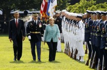 U.S. President Obama and German Chancellor Merkel review US military personnel during official State Arrival ceremony on South Lawn at White House in Washington
