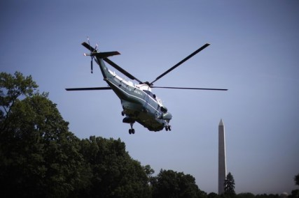 U.S. President Barack Obama lifts off aboard Marine One from the South Lawn of the White House in Washington