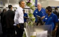 US President Barack Obama (C) purchases