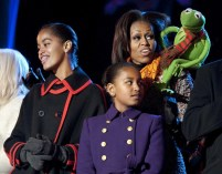U.S. first lady Obama sings a Christmas carol with her daughters Malia (L) and Sasha and Kermit the Frog during the lighting of the National Christmas Tree in Washington