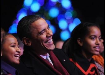 US President Barack Obama laughs with da