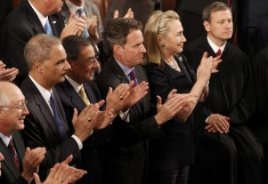 Interior Secretary Salazar, Attorney General Holder, Defense Secretary Panetta, Treasury Secretary Geithner and Secretary of State Clinton applaud as U.S. President Obama delivers his State of the Union address in Washington