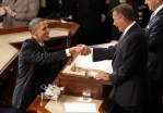 U.S. President Barack Obama (L) shakes hands with House Speaker John Boehner, (R-OH), before Obama's State of the Union address to a joint session of Congress on Capitol Hill in Washington