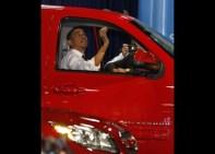 U.S. President Barack Obama sits inside a truck at the 2012 Washington Auto Show in Washington