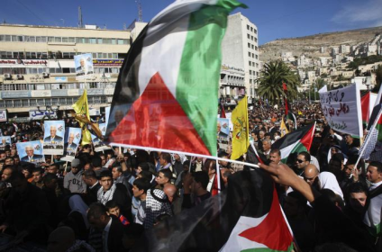 Palestinians rallied in support of the resolution ahead on the UN vote [Reuters]