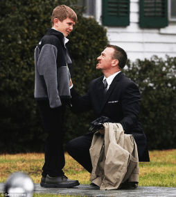 A man comforts a boy outside Honan Funeral Home before the funeral of six-year-old Jack Pinto today which was attended by hundreds