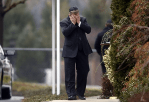 A mourner walks into a funeral service for 6-year-old Noah Pozner, Monday, Dec. 17, 2012