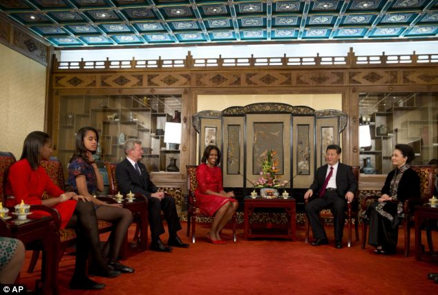 Flotus China Tour- Official figures- Mrs Obama, her daughters Sasha and Malia, U.S. Ambassador to China Max Baucus meet with President Xi Jinping and his wife Peng Liyuan at the Diaoyutai state guesthouse in Beijing