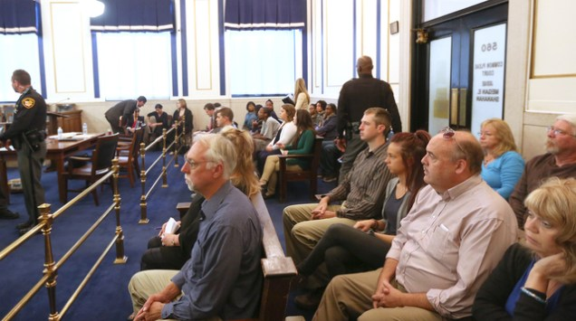 Paul Tensing, father of Ray Tensing, far left, sits in the courtroom during Ray Tensing's trial. Tensing is charged with murder of Sam DuBose during a routine traffic stop on July 19, 2015. Tensing's lawyer, Stew Mathews has said Tensing fired a single shot because he feared for his life. The presiding judge is Megan Shanahan. The Enquirer/ Cara Owsley